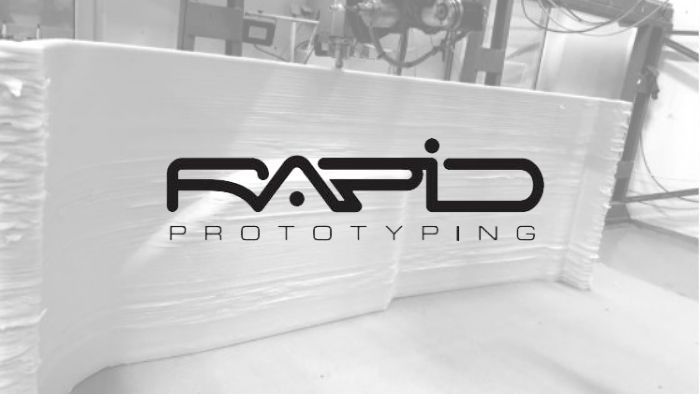 Rapid Prototyping Logo with black and white background picture of 3D printed cabin top